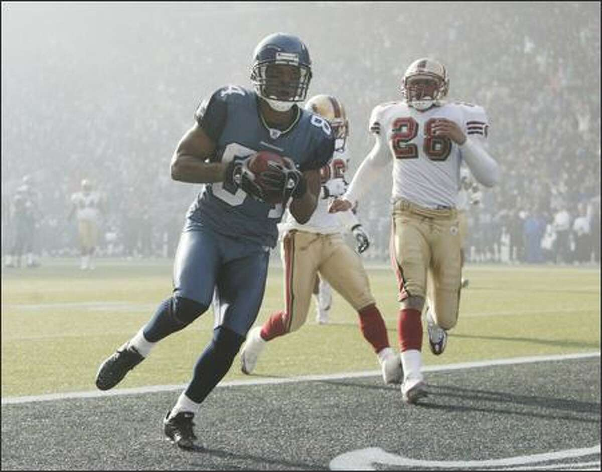 Seahawks' Bobby Engram scores the first touchdown against the San Francisco 49ers during first quarter play.