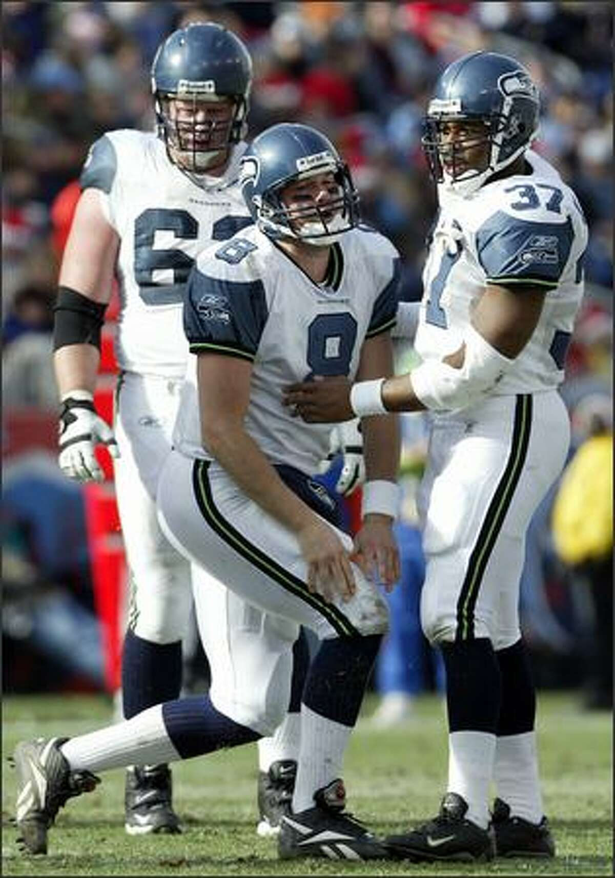Matt Hasselbeck gets a hand from Shaun Alexander after being hit by Tennessee's Albert Haynesworth during the second quarter. Haynesworth hit Hasselbeck after jumping offsides.