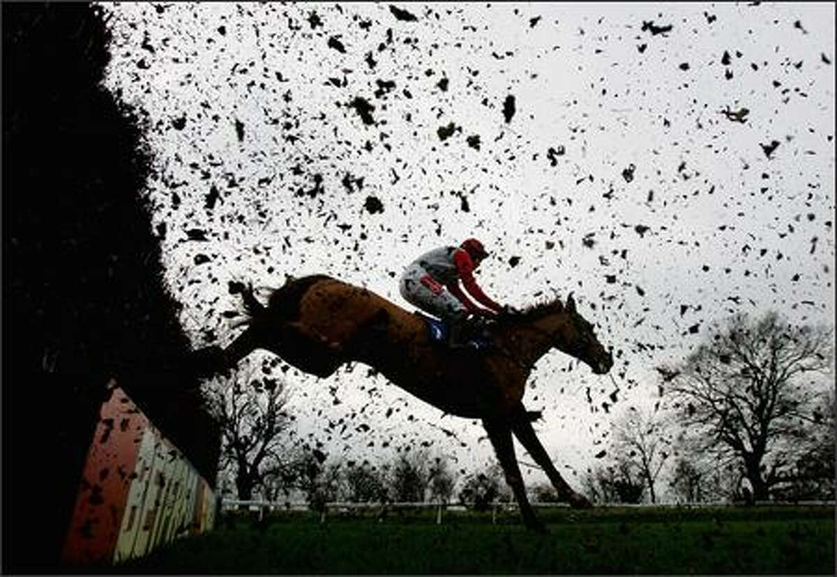 A rider jumps the ditch during the BetFredPoker Novices' Handicap Steeple Chase at Huntingdon Race Course in Huntingdon, England. Photo by Jamie McDonald/Getty Images