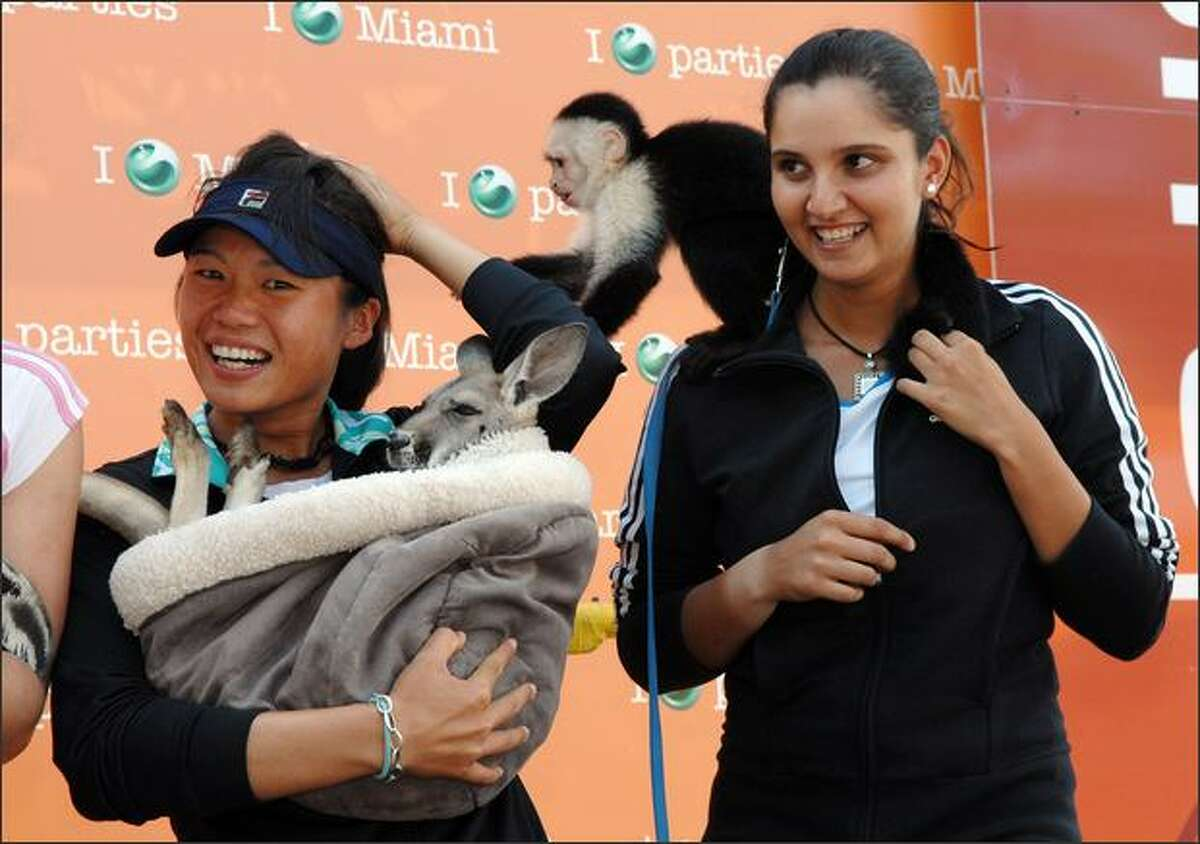 (L-R) Chia-Jung Chuang of Taiwan and Sania Mirza of India pose with zoo animals during day nine of the Sony Ericsson Open at the Crandon Park Tennis Center in Key Biscayne, Florida.