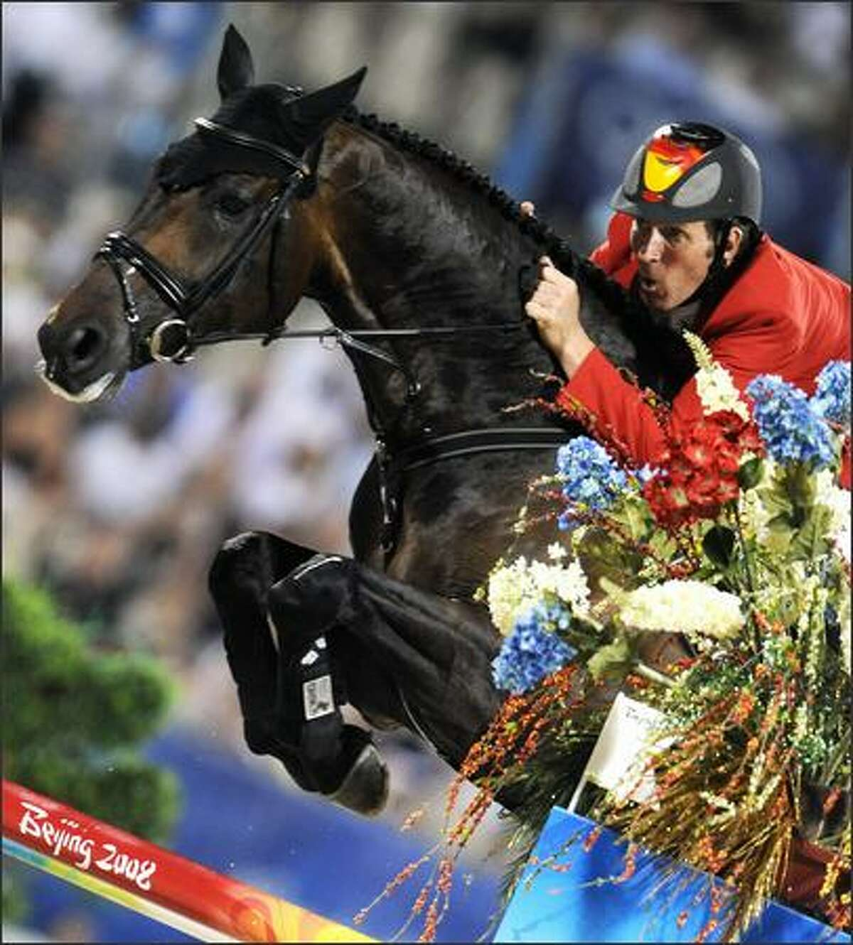 Ludger Beerbaum of Germany rides with