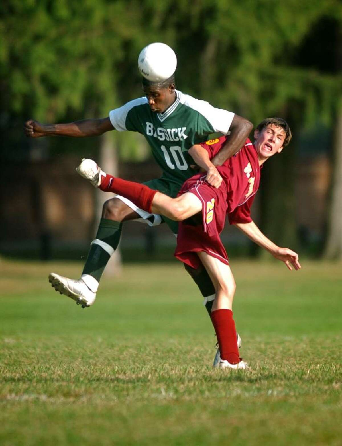 Bassick's Romaro Johnson and St. Joseph's Dan Gallagher battle for the ball during the first half of Wednesday's game at Seaside Park in Bridgeport, Conn.