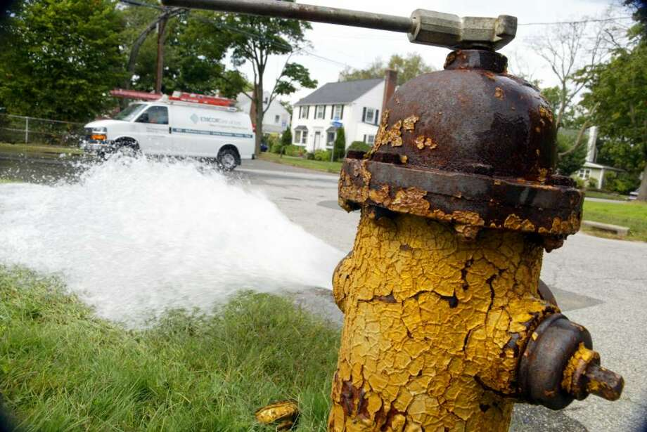An open fire hydrant at West McKinley and Norman Street in Bridgeport, had drivers slowing down on Norman St. as water flowed to a storm drain, Wednesday, Sept. 23, 2009. Photo: Phil Noel / Connecticut Post
