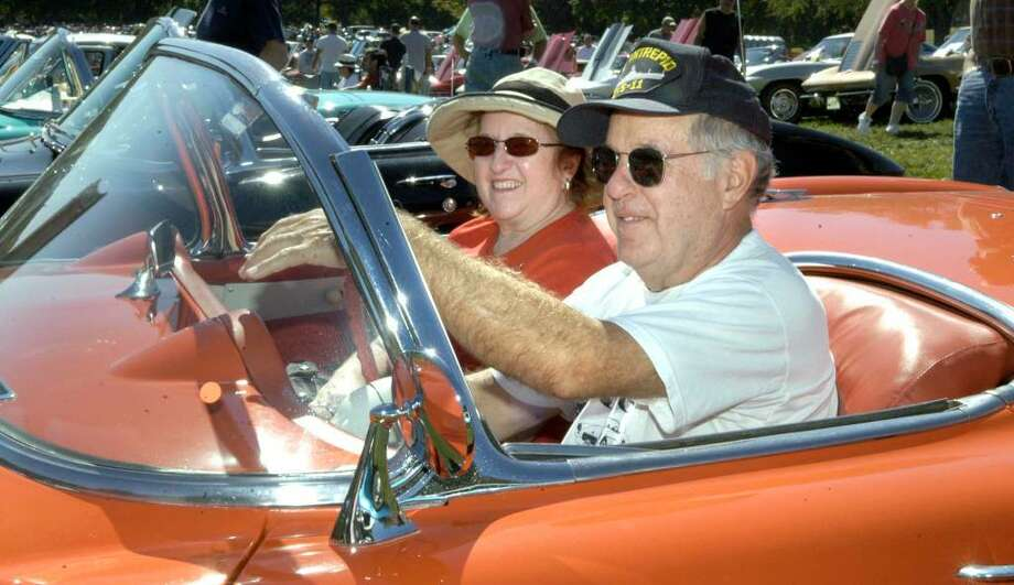 Chris and Rich Engel of Sherman driving their 1956 Corvette that they had on display at the Roaring 20'sAntique and Classic Car Club show held on the grounds of the Southbury Training School Sunday, Sept. 20, 2009 Photo: Carol Kaliff / The News-Times