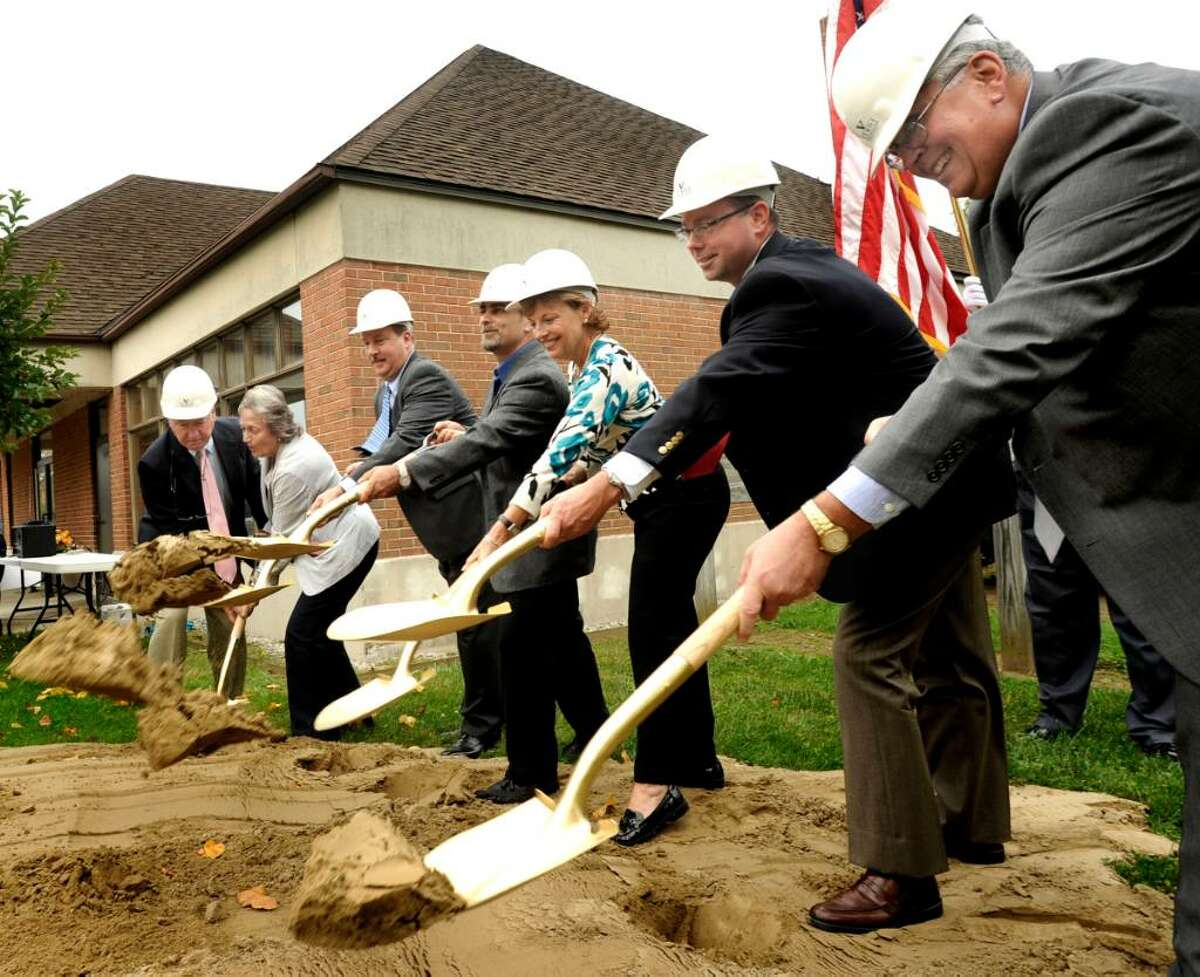 VIP's shovel dirt during thje ceremonial groundbreaking for the Brookfield Senior Renovation and Expansion on Wednesday, Sept. 23,2009. From right are: Robert Silvaggi, Kurt Verdi, Ellen Melville, Paul Checco, Joni Park, and Jerry Murphy.