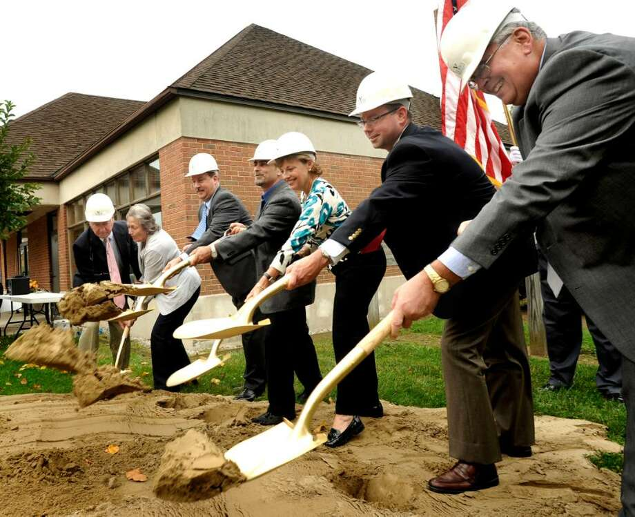 VIP's shovel dirt during thje ceremonial groundbreaking  for the Brookfield Senior Renovation and Expansion on Wednesday, Sept. 23,2009. From right are: Robert Silvaggi, Kurt Verdi, Ellen Melville, Paul Checco, Joni Park, and Jerry Murphy. Photo: Michael Duffy / The News-Times
