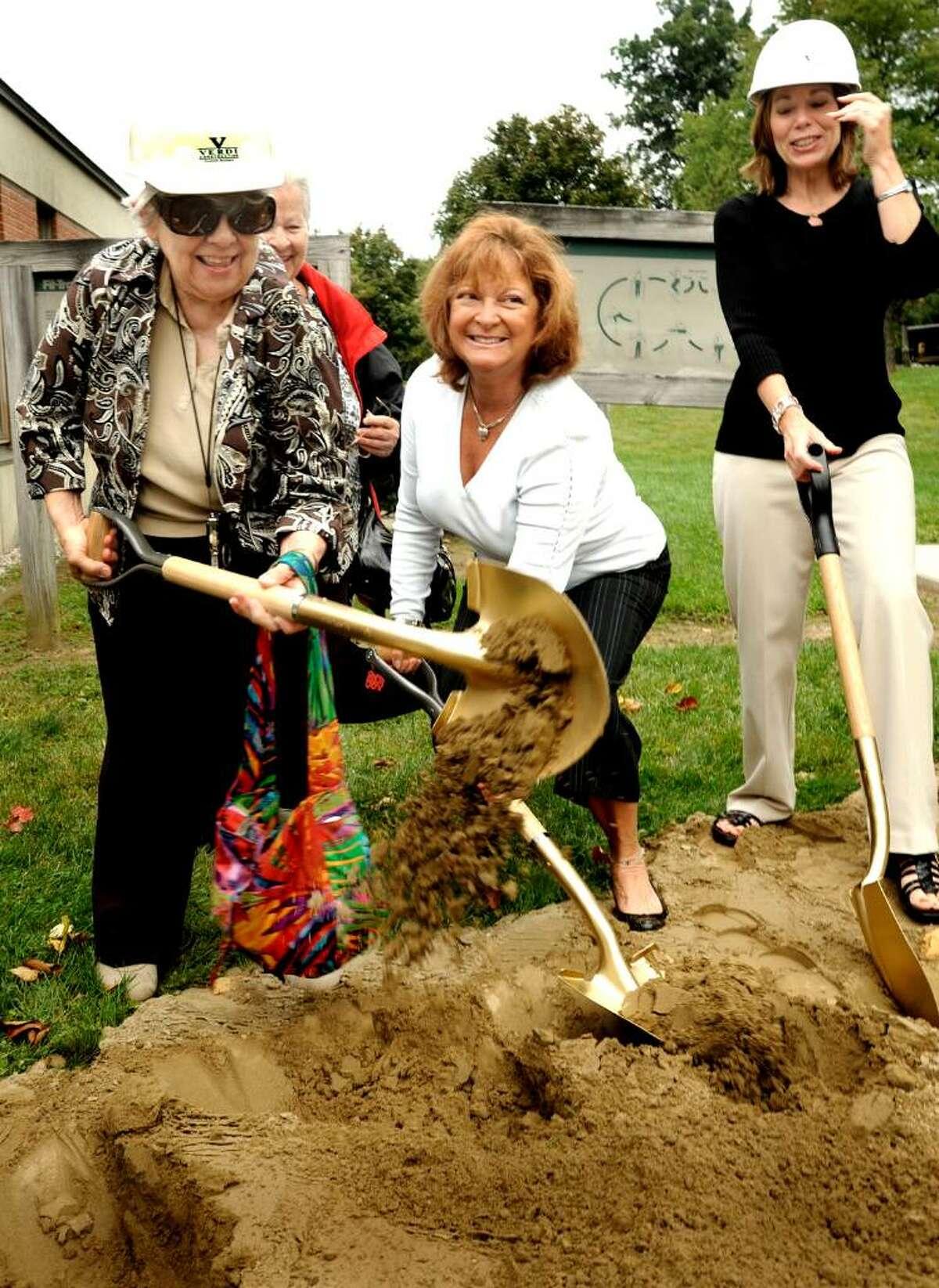 Millie Foster, 74, left, Arlene Farrell, center, and Gail Pellis shovel dirt during groundbreaking ceremonies for the Brookfield Senior Renovation and Expansion on Wednesday, Sept. 23,2009.