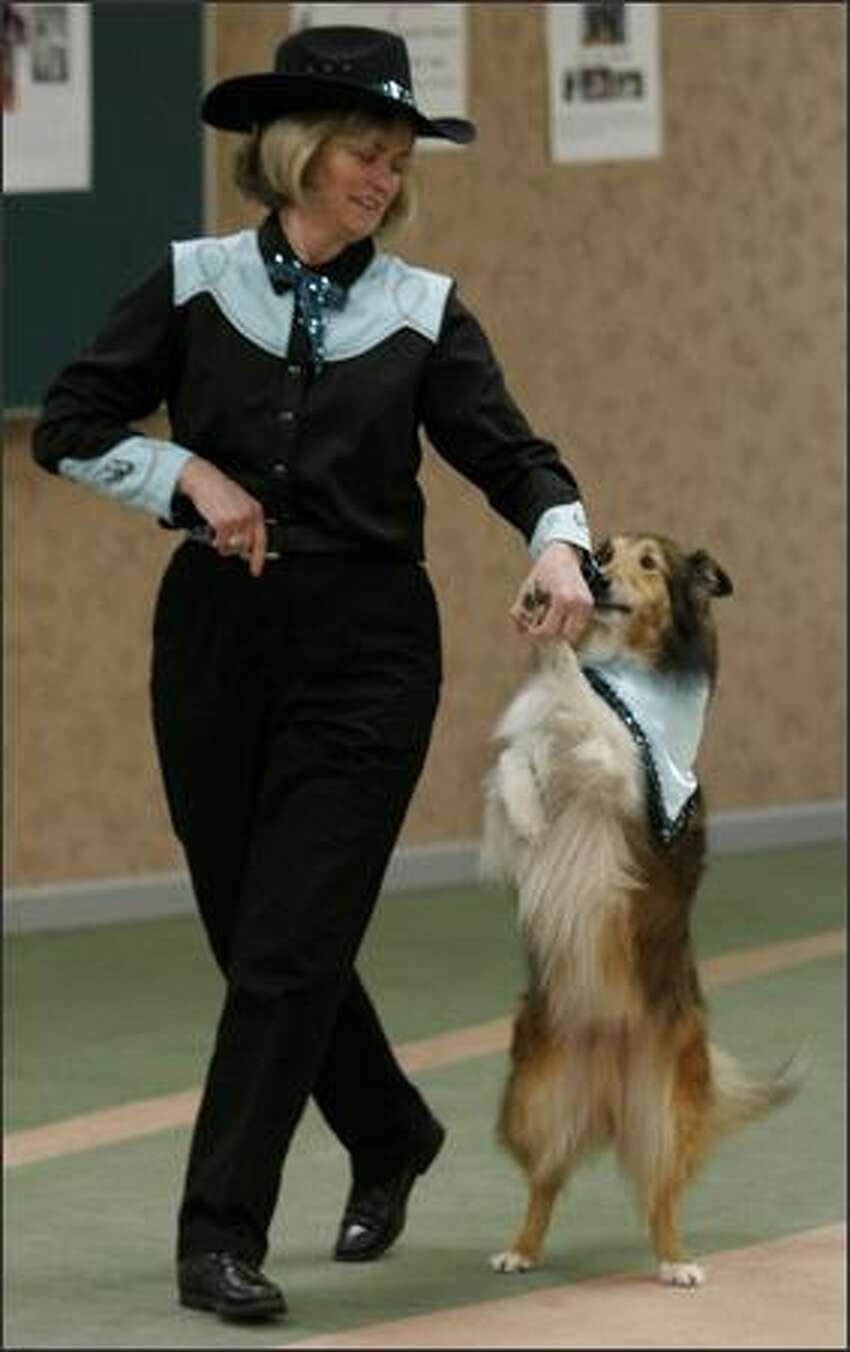 Annette Granbois of Langley, B.C., line dances with Odie during the Intermediate competition.