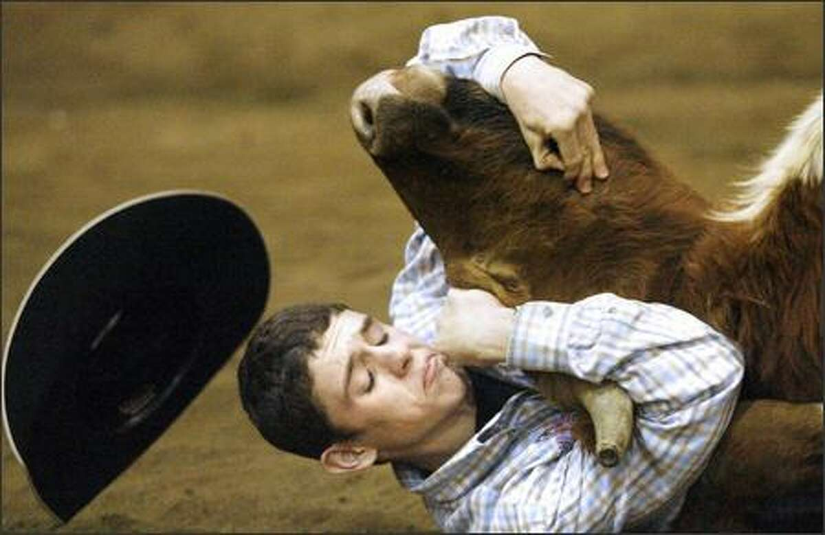 Tydanial Haller competes in the chute dogging event at the Championship 4-State Youth Rodeo at the Clark County Fairgrounds in Springfield, Ohio, Saturday, Dec. 15, 2007. (AP Photo/Springfield News-Sun, Barbara J. Perenic)