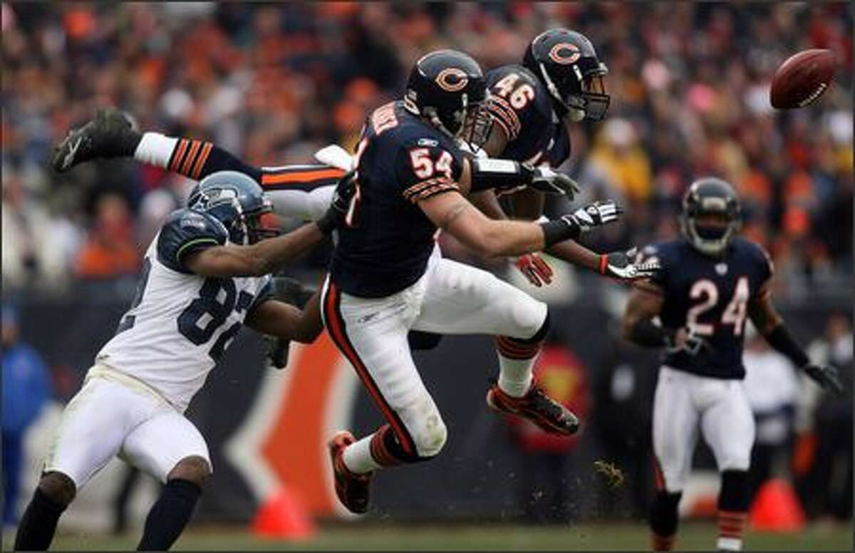 Chicago Bears linebacker Brian Urlacher (54) and Chicago Bears safety Chris Harris (46) break up the pass play intended for Seattle Seahawks wide receiver Darrell Jackson (82)during second quarter action.
