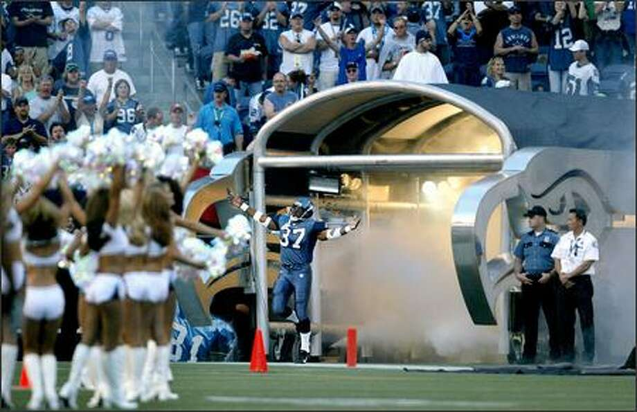 Shaun Alexander dances onto the field as he is introduced prior to the start of the game. Photo: Scott Eklund, Seattle Post-Intelligencer / Seattle Post-Intelligencer
