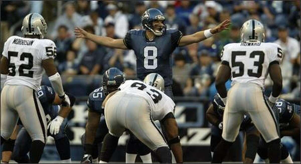 Seahawks quarterback Matt Hasselbeck prepares his line in the first quarter.