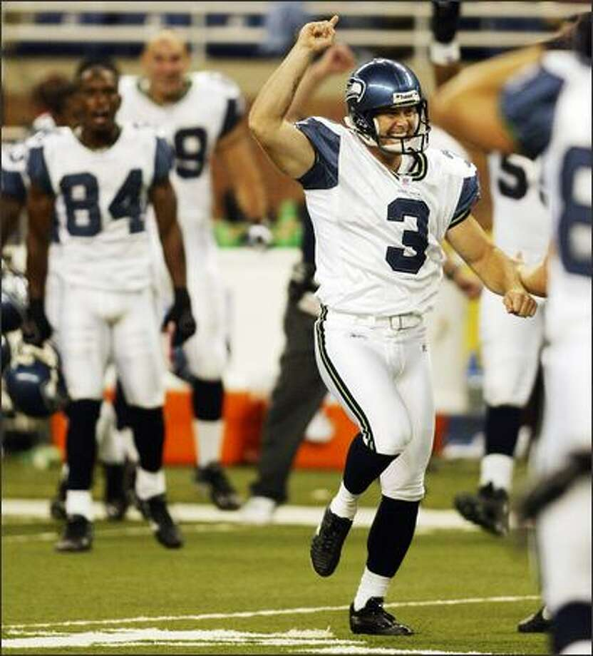 Seahawks Josh Brown celebrates his game-winning field goal over the Detroit Lions during fourth quarter action at Ford Field in Detroit. Photo: Mike Urban, Seattle Post-Intelligencer / Seattle Post-Intelligencer