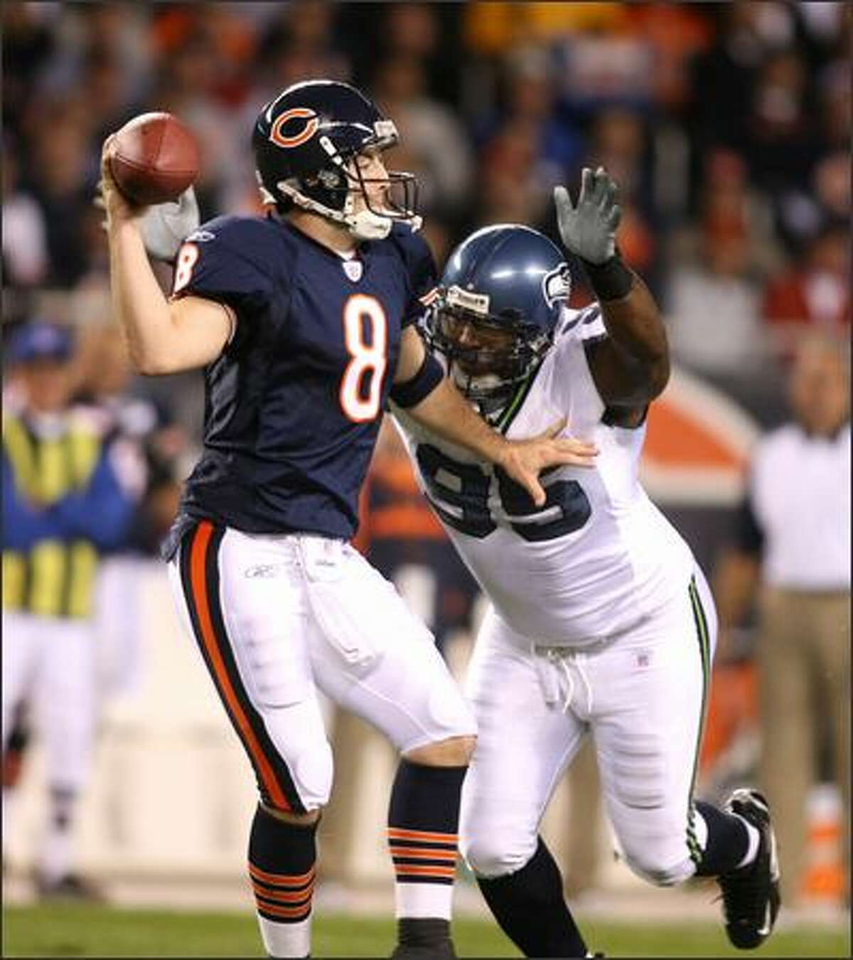 Bears quarterback Rex Grossman gets sacked in the first quarter by Seahawks defender Russell Davis.