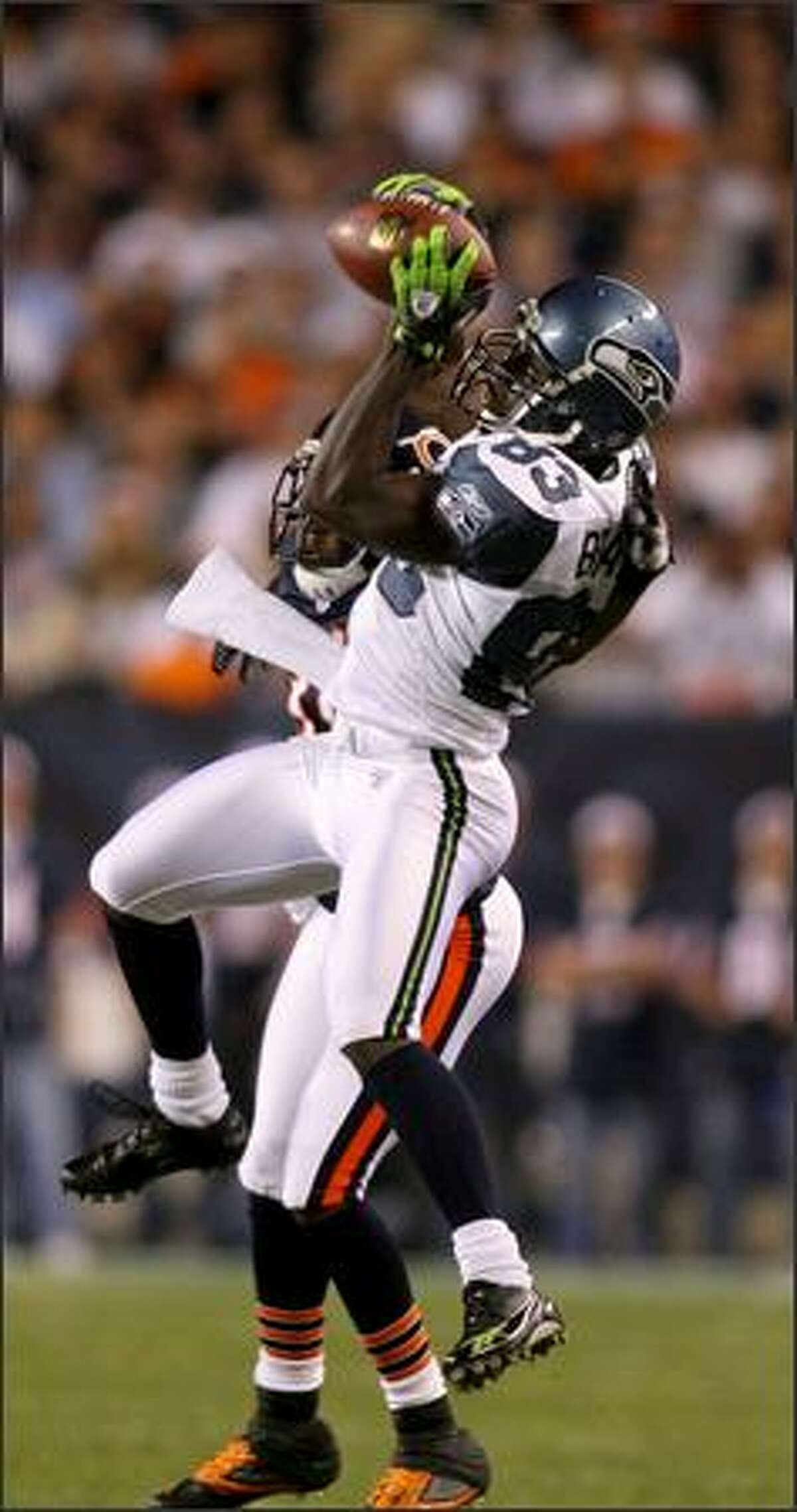 Deion Branch hauls in one of his three catches for 57 yards, a 31-yarder in the first quarter.