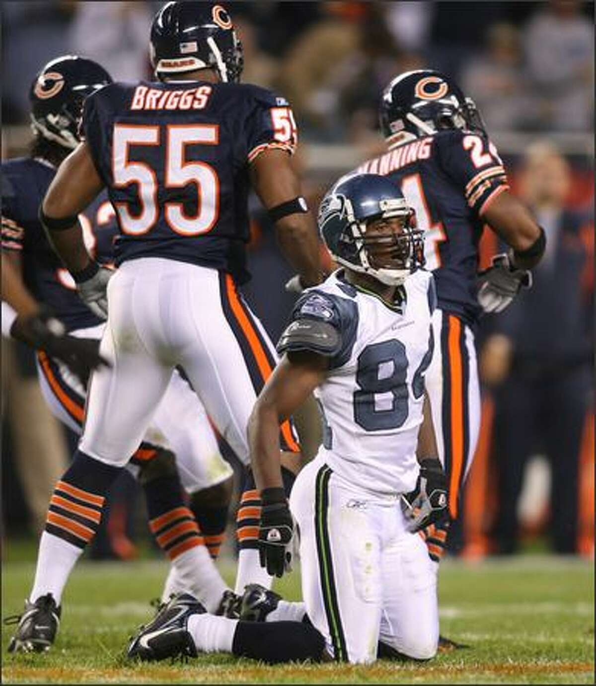 Bobby Engram shakes off a big hit after Bears cornerback Ricky Manning Jr. prevented the Seahawks receiver from hanging onto a pass in the first quarter.
