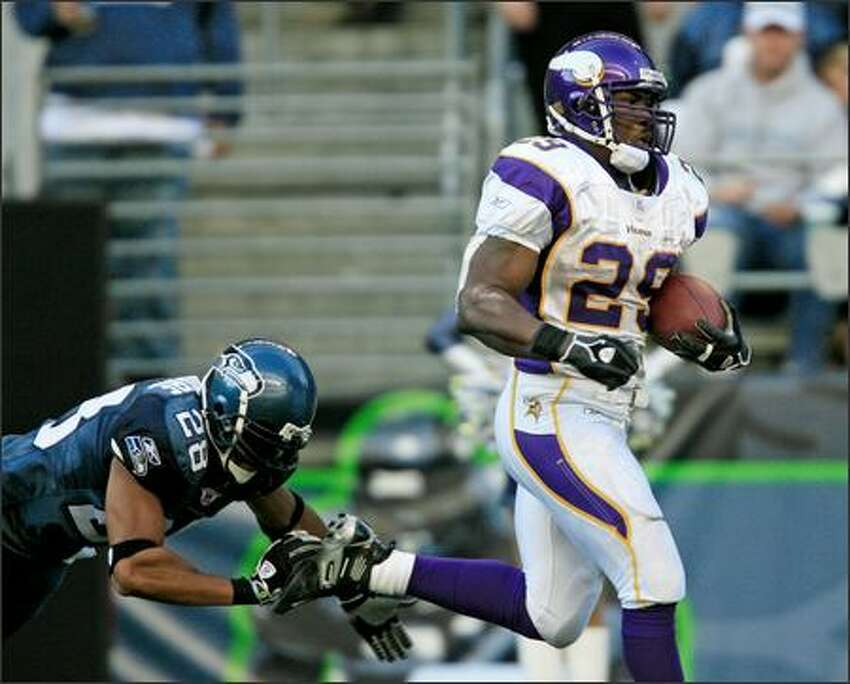 Vikings running back Chester Taylor eludes a last-ditch dive by safety Peter Boulware on the way to a 95-yard score, the longest-ever run by a Seattle opponent.