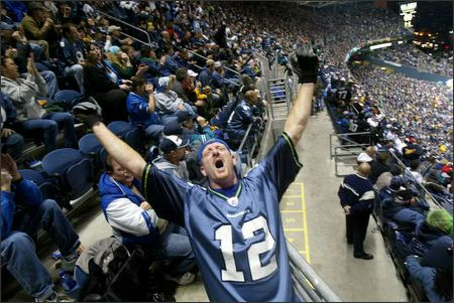 Mike Armbruster from Bremerton tries to get fans all riled up in the Upper Concourse South section during the game. Photo: Karen Ducey, Seattle Post-Intelligencer / Seattle Post-Intelligencer