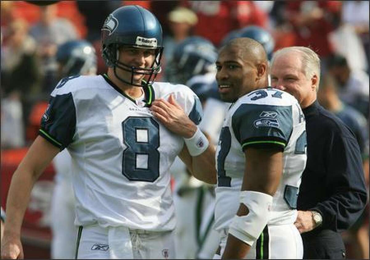 Seahawks quarterback Matt Hasselbeck and running back Shaun Alexander talk before their game against the 49ers at Monster Park in San Francisco.