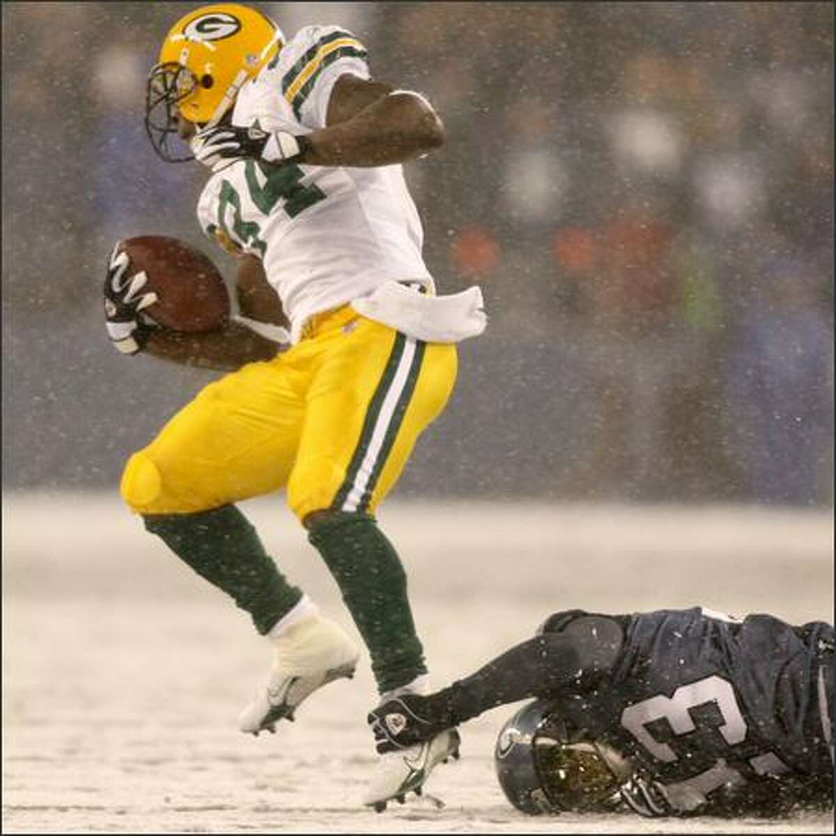 Marcus Trufant tries for an ankle tackle of Packers' running back Vernand Morency in the first quarter as the Seattle Seahawks play the Green Bay Packers on Monday Night Football.