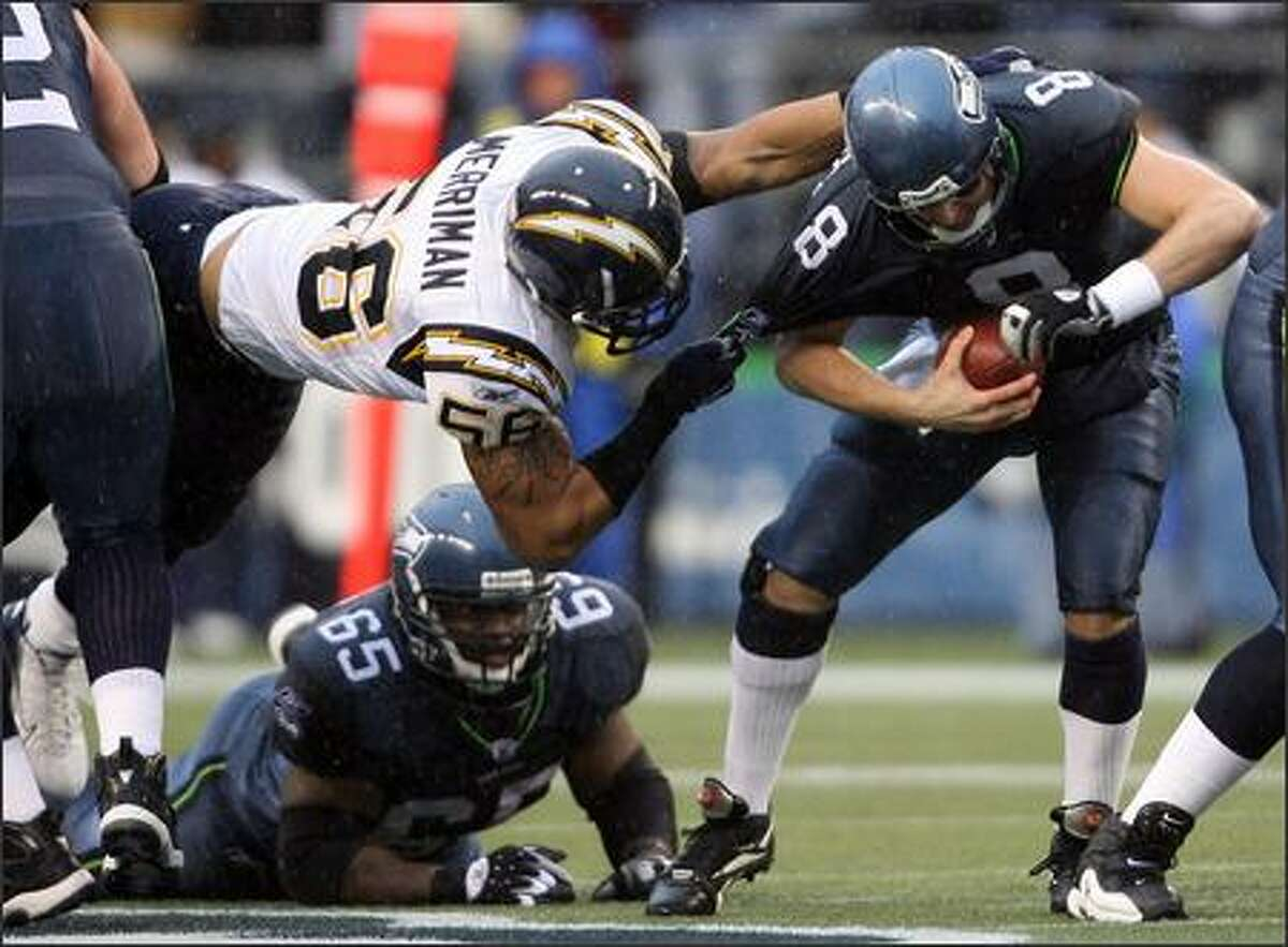 Seahawks quarterback Matt Hasselbeck is sacked by San Diego Chargers linebacker Shawne Merriman (56) for a loss of five yards during first quarter action.