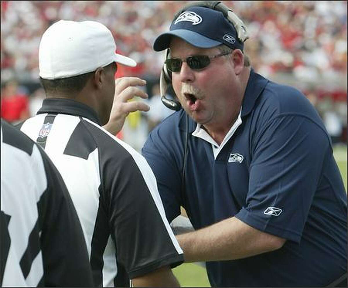 Seahawks coach Mike Holmgren lets referee Jerome Boger know he isn't happy as D.J. Hackett's apaprent touchdown in the second quarter was overturned.