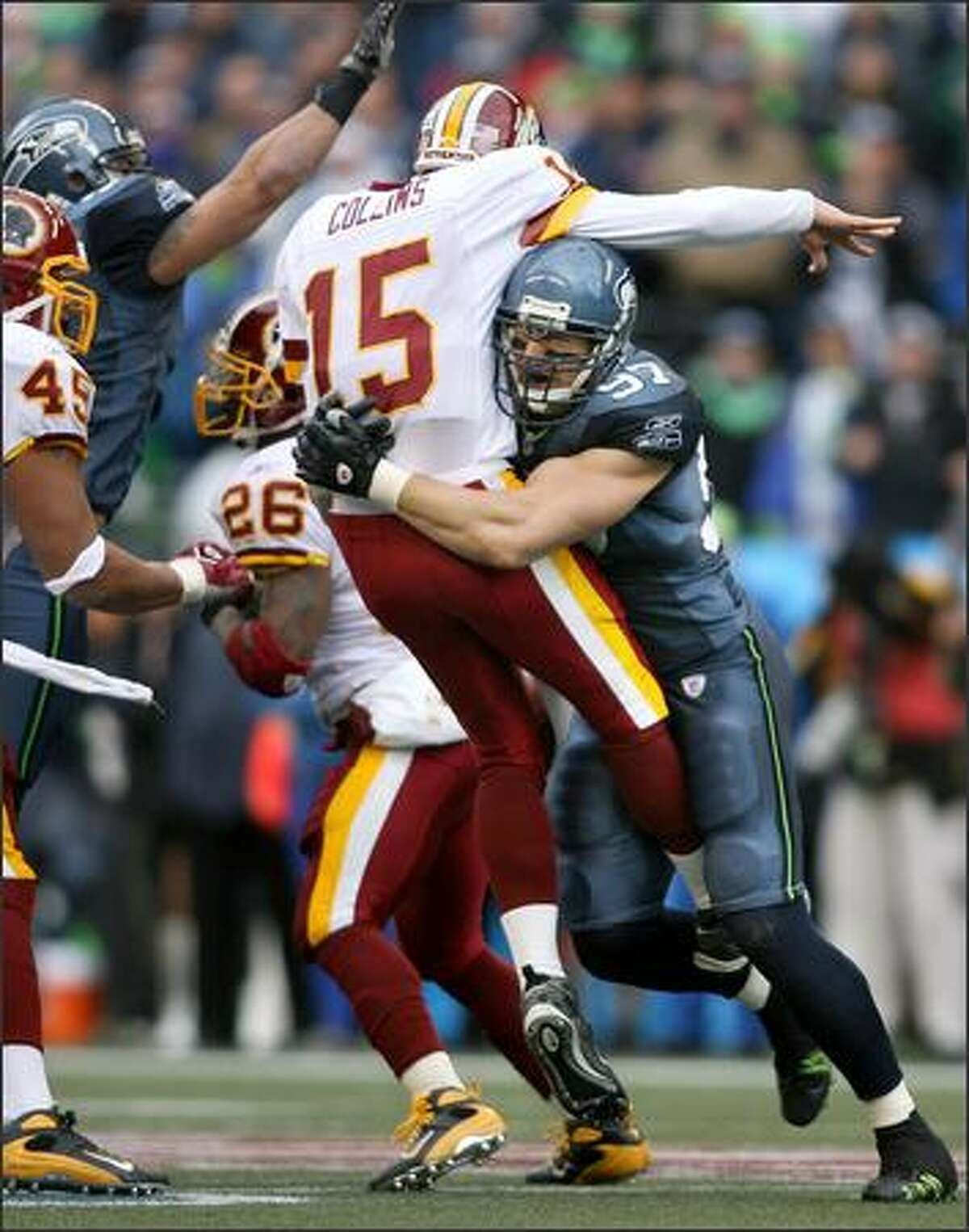 Redskins quarterback Todd Collins releases an incomplete pass just before being hit hard by Seahawks defensive end Patrick Kerney in the first quarter.