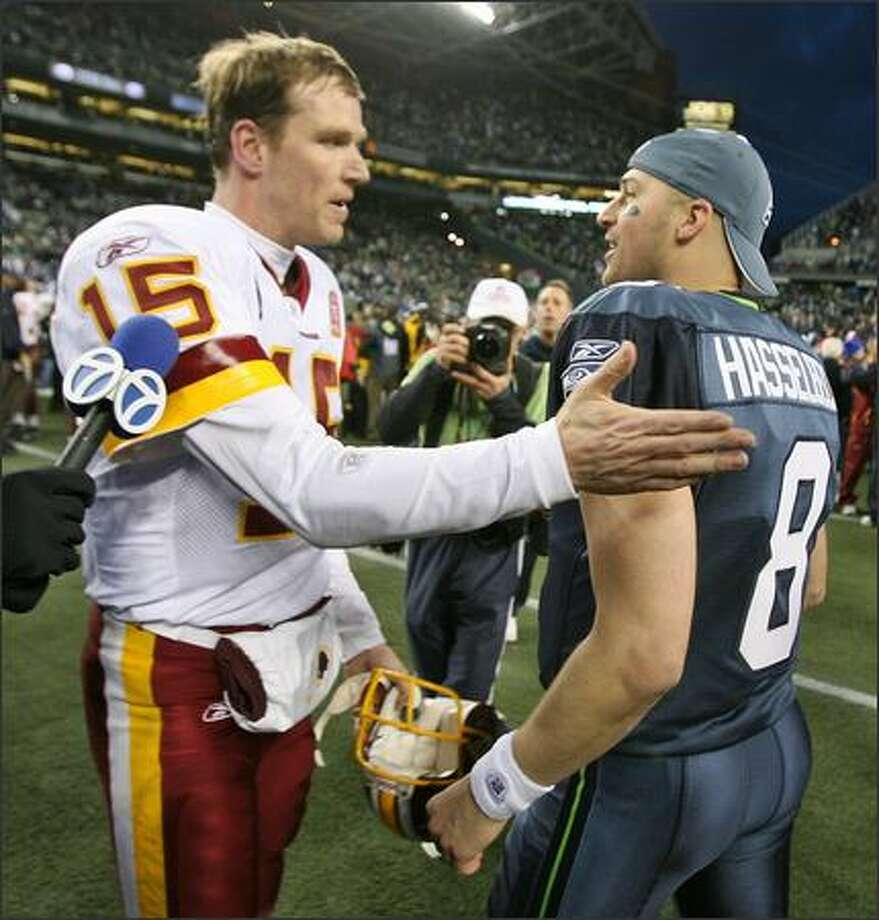 Seahawks quarterback Matt Hasselbeck is congratulated by Redskins quarterback Todd Collins after the game. Photo: Mike Urban, Seattle Post-Intelligencer / Seattle Post-Intelligencer