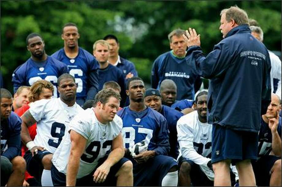 Seattle Seahawks head coach Mike Holmgren speaks to his team after the final practice of the last mini-camp in Kirkland, WA on Thursday, June 14, 2007. The next practice will be training camp, which begins July 28. Photo: Dan DeLong, Seattle Post-Intelligencer / Seattle Post-Intelligencer