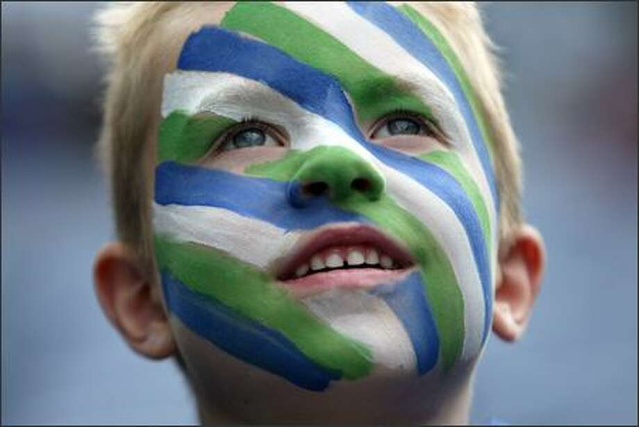 Seattle Seahawks fan Bryce Porter, 6, from Puyallup, has his game face on as he gazes in awe at the stadium as the Hawks prepare to face the Minnesota Vikings at Qwest Field in Seattle, Wash., Saturday August 24, 2007. Photo: Mike Urban, Seattle Post-Intelligencer / Seattle Post-Intelligencer