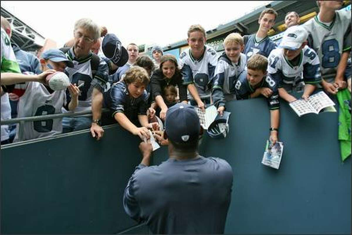 Seattle Seahawks tight end Marcus Pollard (88) signs for the fans prior to the Seahawks game against the Minnesota Vikings at Qwest Field in Seattle, Wash., Saturday August 24, 2007.