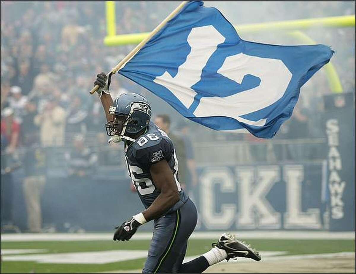 Seattle Seahawks wide receiver Courtney Taylor with the 12th man flag before Seattle's preseason game.