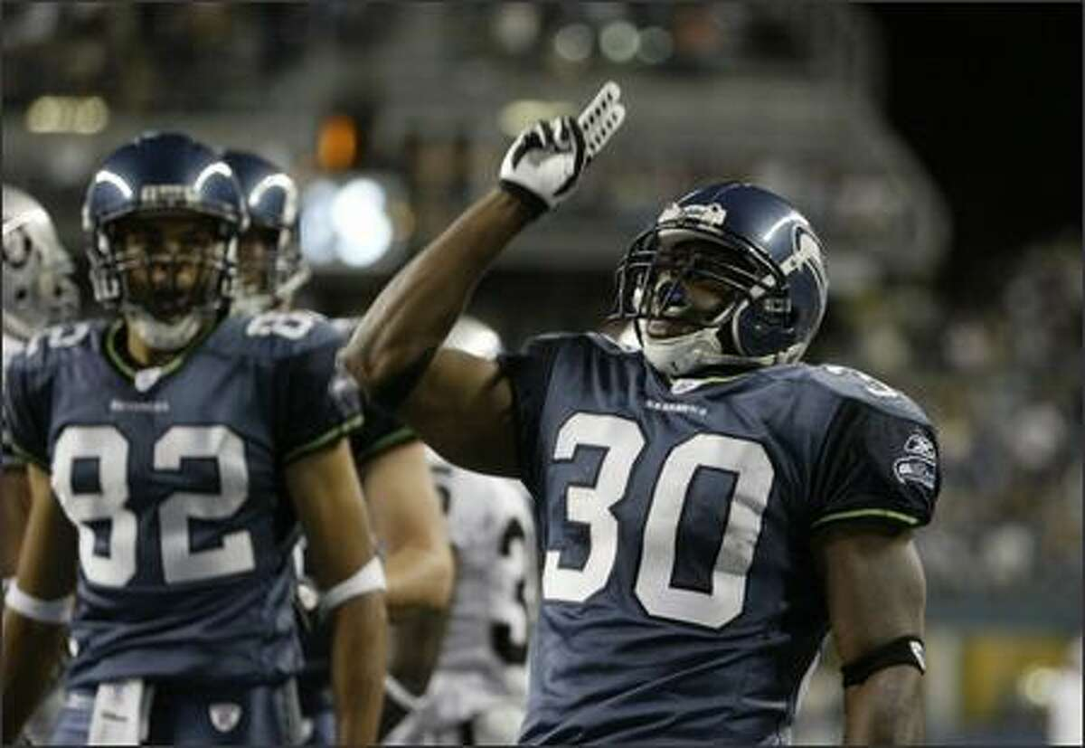 Seattle Seahawks' Marquis Weeks (30) celebrates after an 11-yard touchdown run in the fourth quarter at Qwest Field in Seattle.