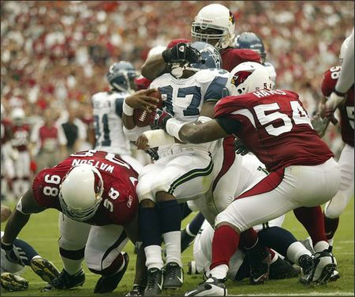 Seattle Seahawks running back Shaun Alexander is held to no gain by the Cardinals defense near the goal line in the 2nd quarter.