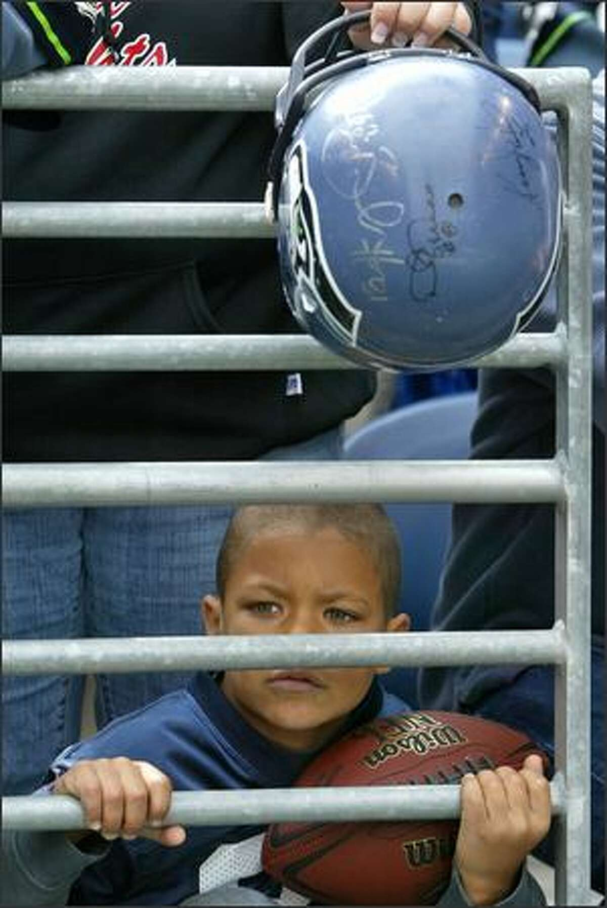 Seattle Seahawks fan Jeffery McMillan, 8, waits to catch an autograph from one of the Seahawks players prior to their game against the Cincinnati Bengals at Qwest Field on Sunday Sept. 23, 2007.