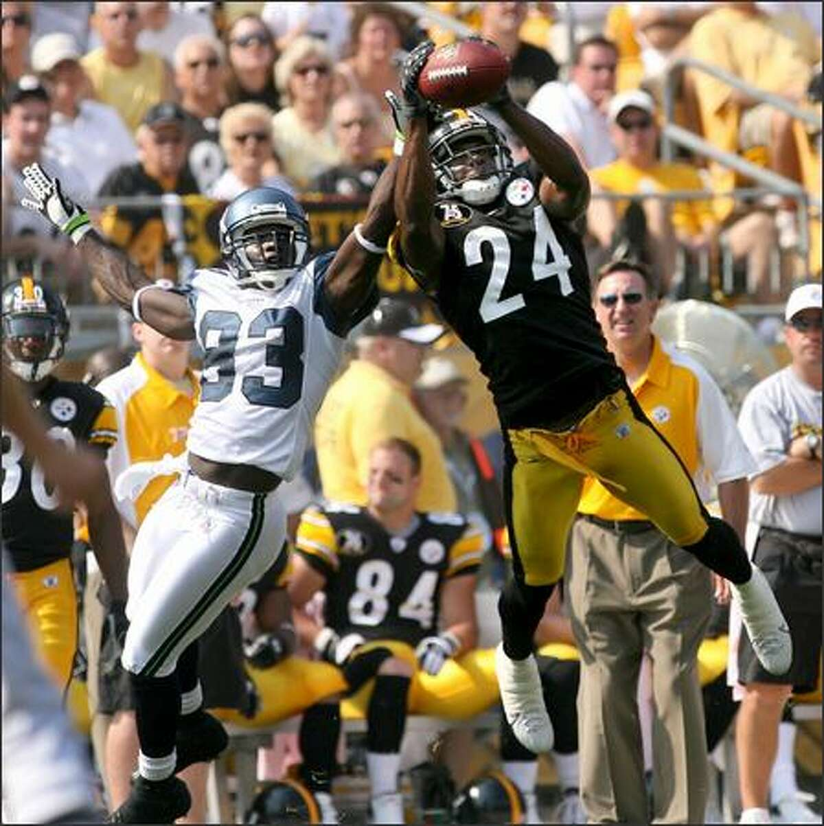Steelers cornerback Ike Taylor steps in front of Deion Branch in the first quarter, but can't hold onto the ball for the interception.