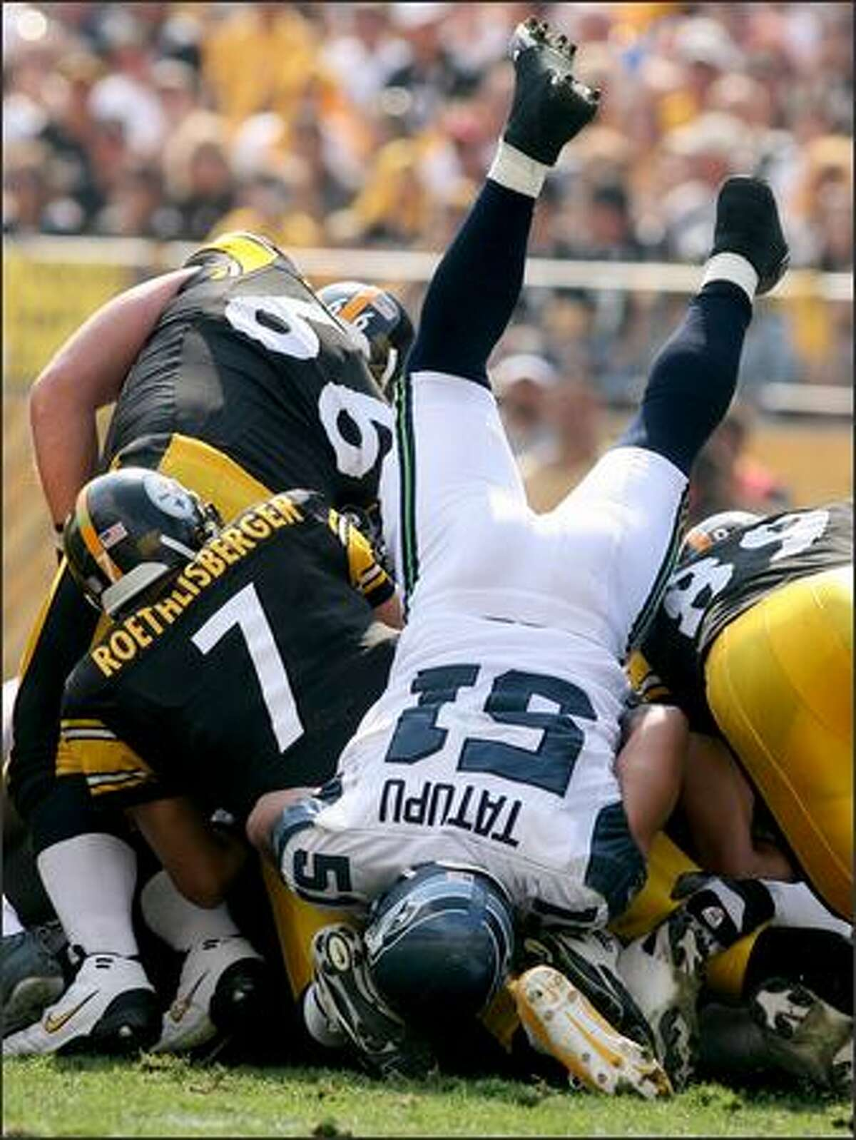 Seahawks linebacker Lofa Tatupu dives over the pile but is unable to stop Steelers quarterback Ben Roethlisberger on a third and short in the first half.