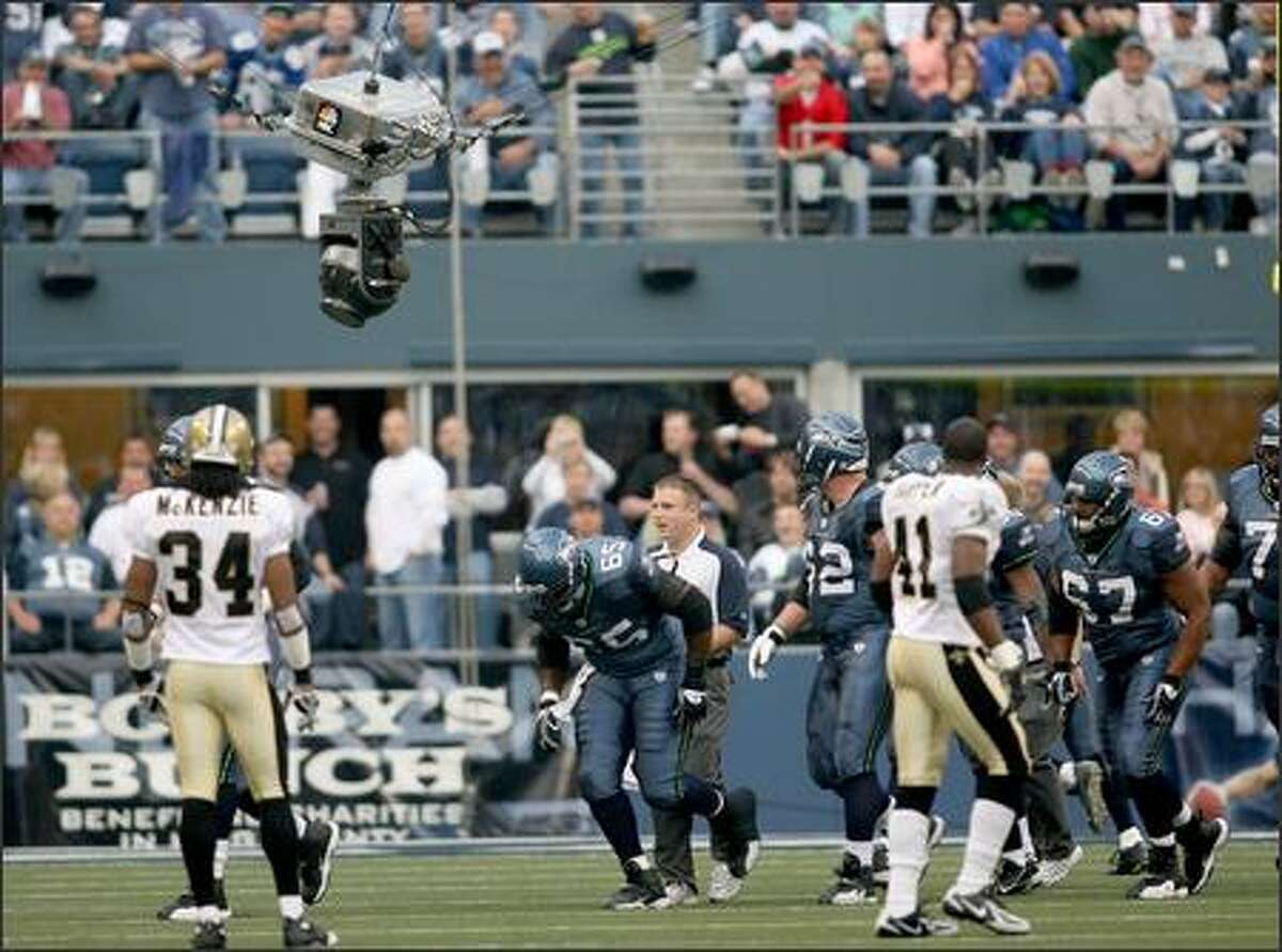 Seahawks center Kris Spencer ducks as the aerial camera drops down onto the field in the first quarter.