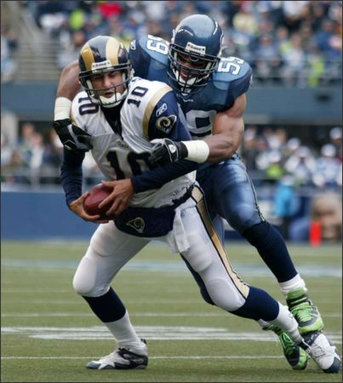 Seattle Seahawks linebacker Julian Peterson sacks St. Louis Rams quarterback Marc Bulger during the 1st quarter.