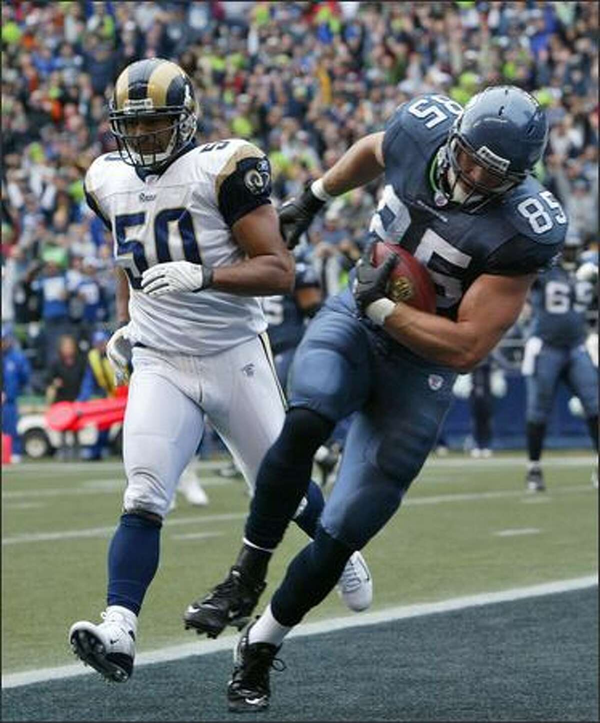 Seattle Seahawks' Will Heller beats St. Louis Rams' Pisa Tinoisamoa to the endzone for the Seahawks first touchdown during the 1st quarter.