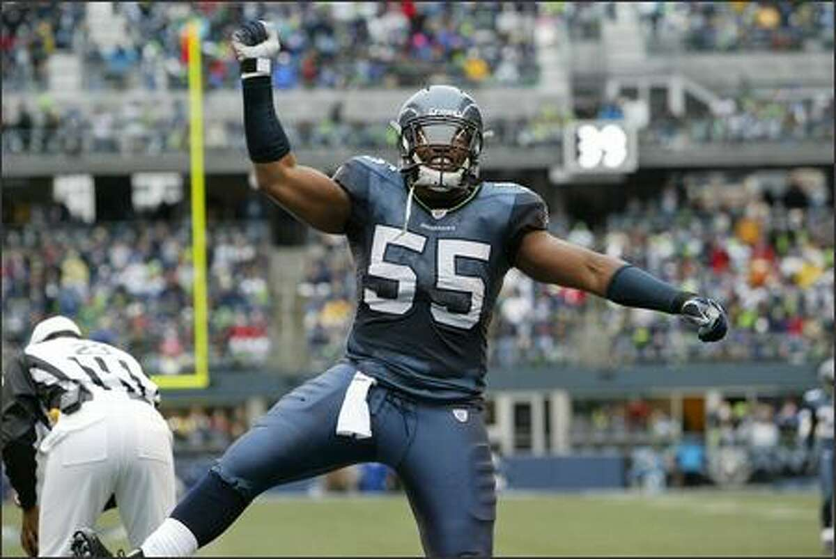 Seattle Seahawks' Darryl Tapp celebrates his sack of St. Louis Rams' Marc Bulger during the second quarter.