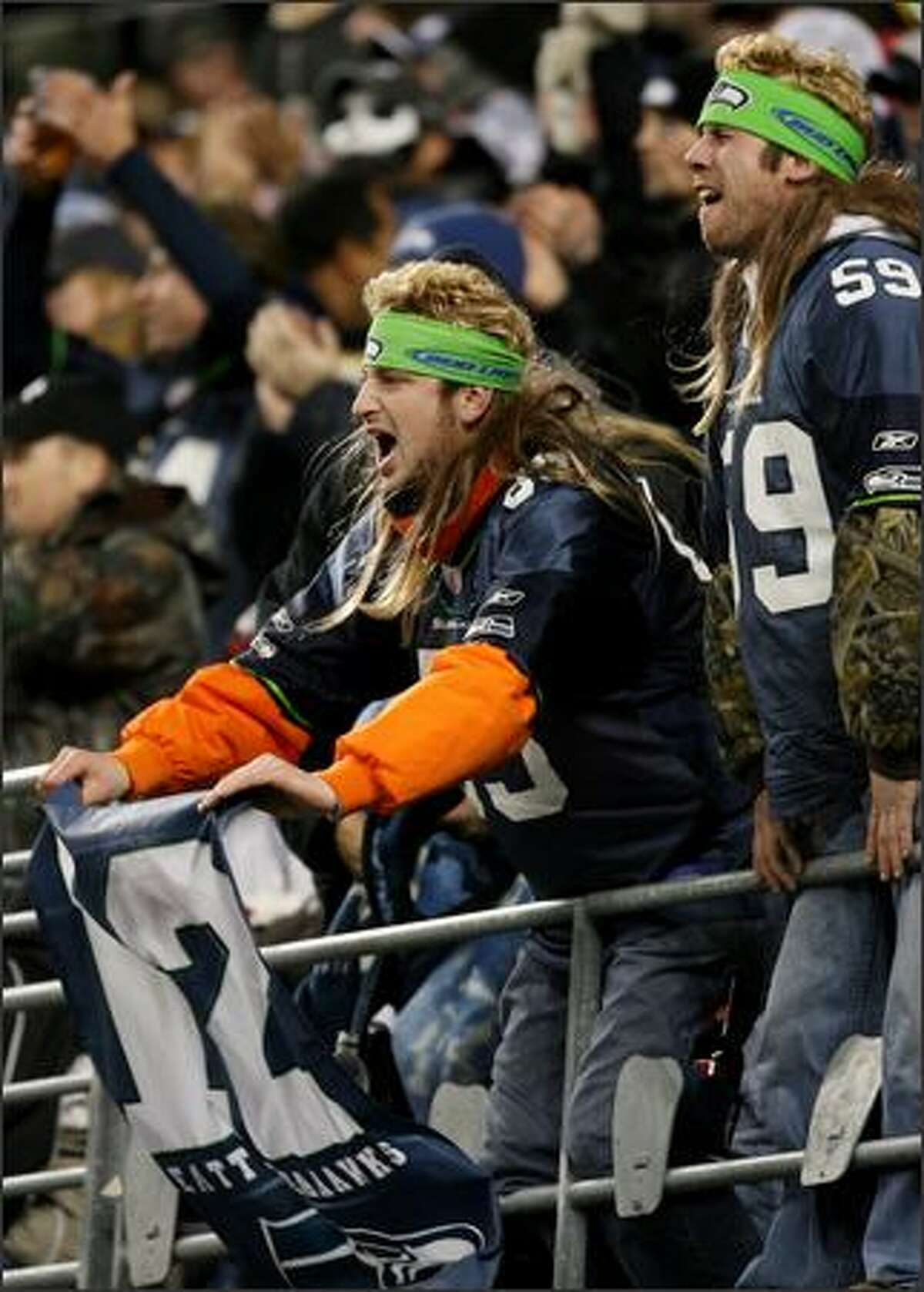 Seahawks fans react after the 49ers were called for consecutive false starts during the 1st quarter at Qwest Field.