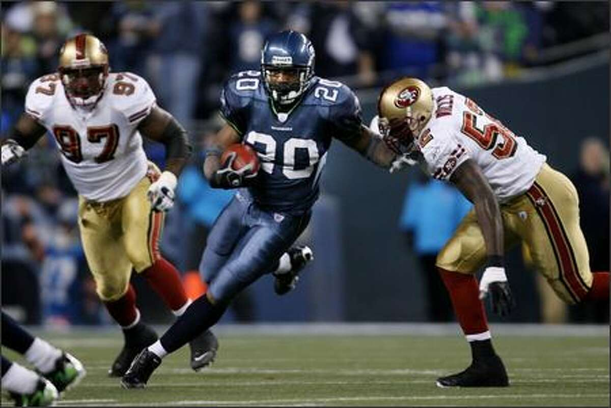 Seattle Seahawks running back Maurice Morris, starting for an injured Shaun Alexander, runs for a 4-yard gain against the 49ers during the 1st quarter at Qwest Field.