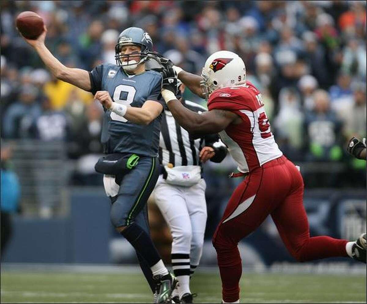 Seattle Seahawks quarterback Matt Hasselbeck passes the ball as Arizona Cardinals linebacker Calvin Pace pursues him during the 1st quarter.