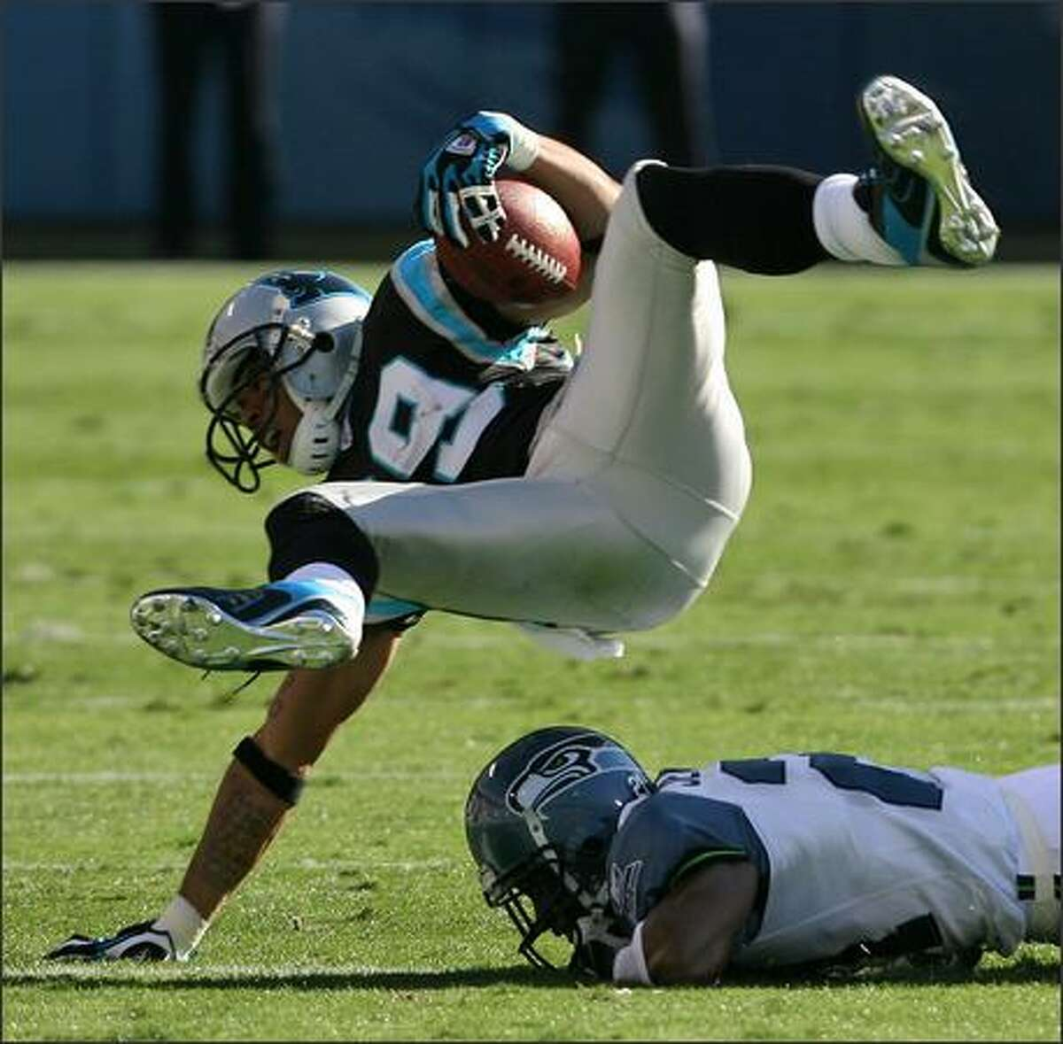 Carolina Panthers wide receiver Steve Smith is dropped for a loss of one yard by Seattle Seahawks cornerback Kelly Jennings during the first quarter.