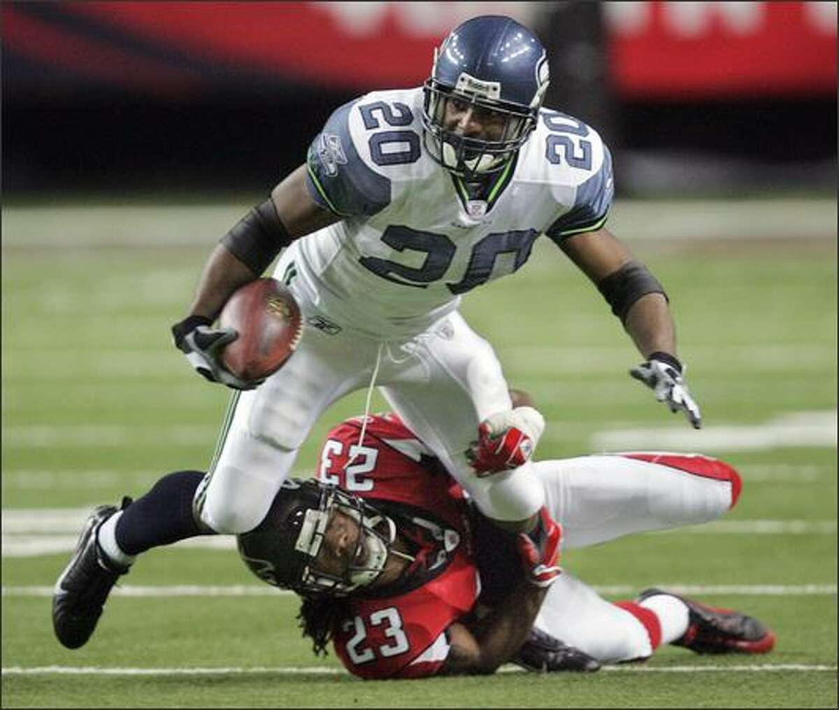 Seattle Seahawks running back Maurice Morris is stopped by Atlanta Falcons' Chris Houston after making a catch during the first quarter.