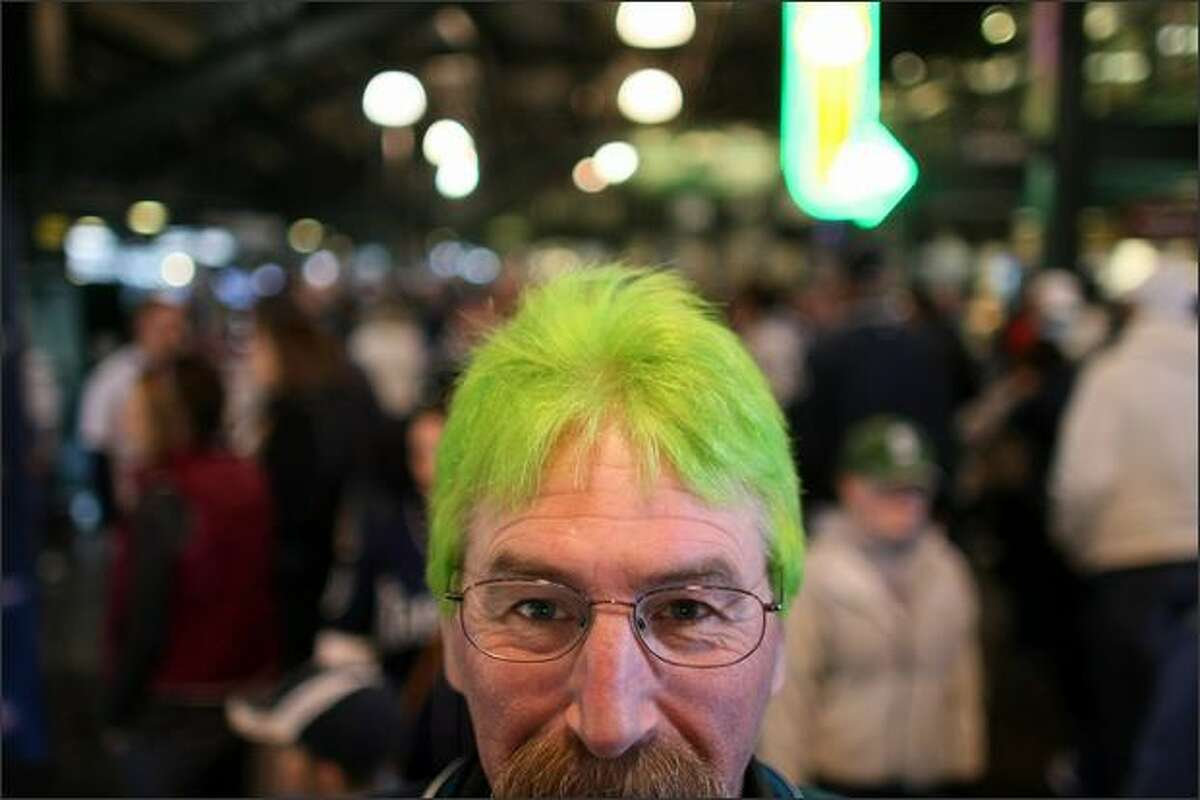 Dave Chapman of Arlington shows off his Mariner green dyed hair during the Seattle Mariners season opener at Safeco in Seattle.