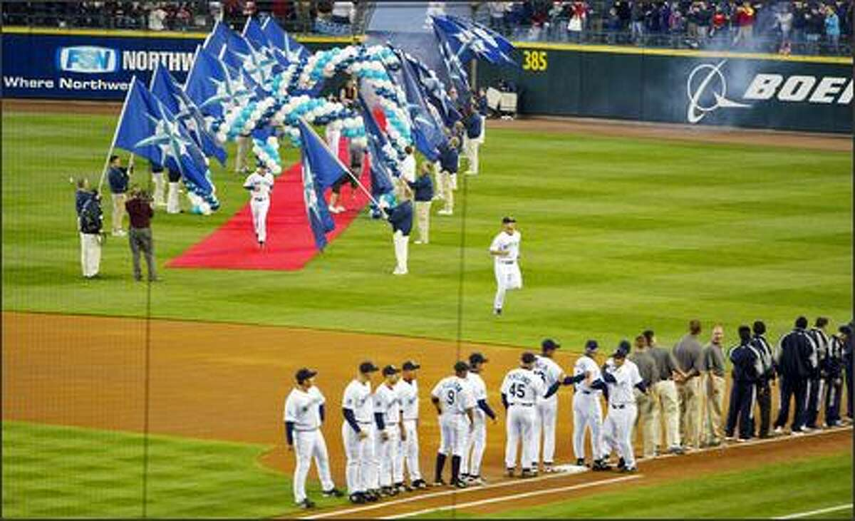 The Mariners players are introduced prior to the Mariners home opener.
