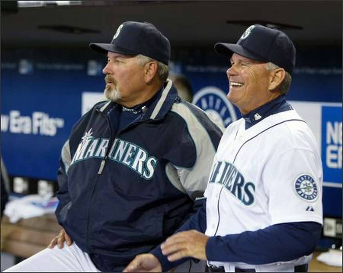Mariners manager Mike Hargrove, left, looks out of the dugout with bench coach John McLaren before opening day.