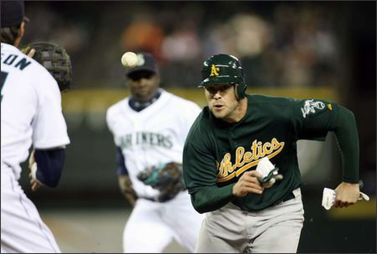 Oakland Athletics Bobby Crosby is picked off by Seattle Mariners Richie Sexson and Jose Lopez as he was caught trying to steal second base during second inning action at Safeco Field in Seattle, Wash., Tuesday April 3, 2007.